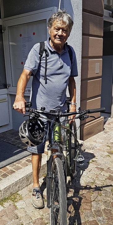 Das Fahrrad ist sein Markenzeichen – Klaus Schneidewind   | Foto: Axel Kremp