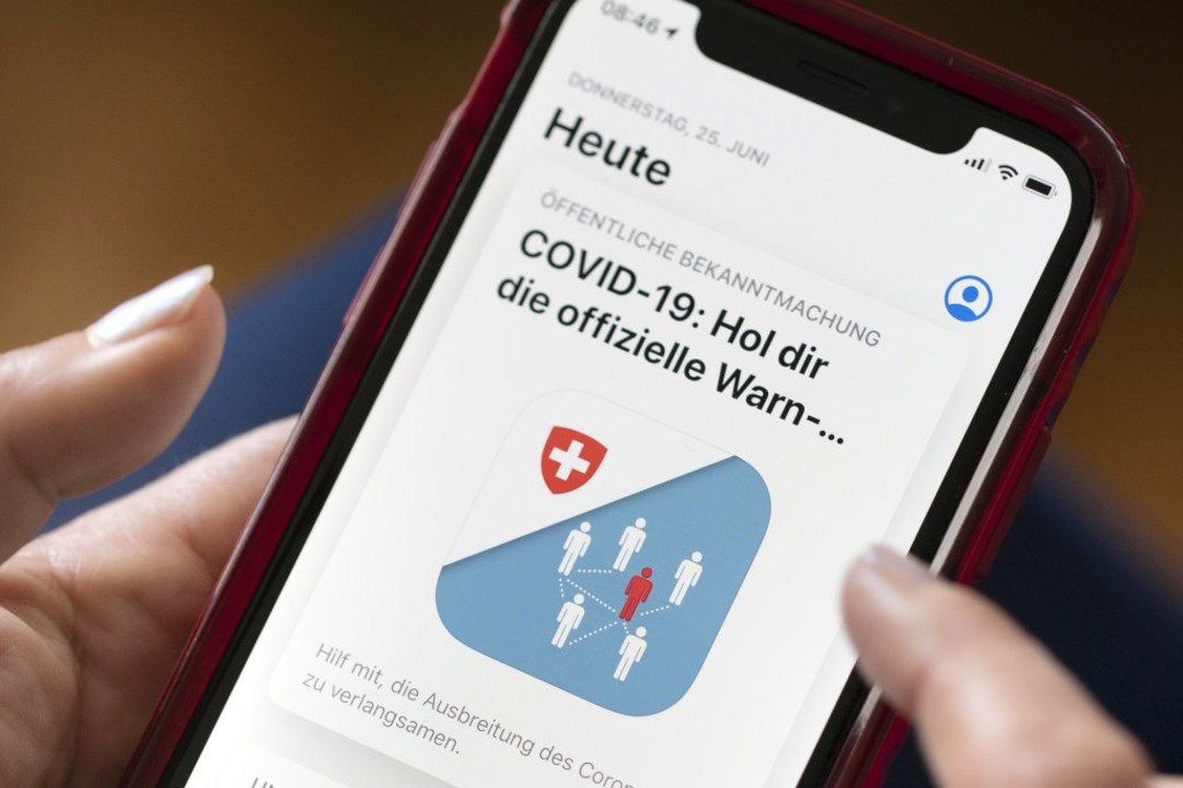 Grenzüberschreitend funktioniert die Schweizer App noch nicht.    Foto: Gaetan Bally (dpa)