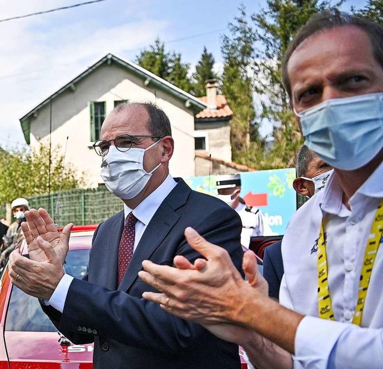 Der französische Premierminister Jean ...me bei der Pyrenäen-Etappe am Samstag.    Foto: ANNE-CHRISTINE POUJOULAT (AFP)