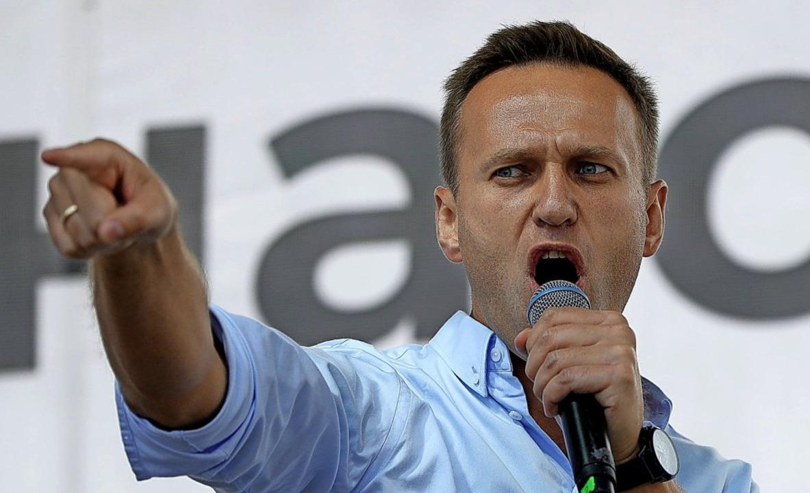 Alexei Nawalny ist das bekannteste Ges...er bei einem Auftritt im Sommer 2019).    Foto: Pavel Golovkin (dpa)