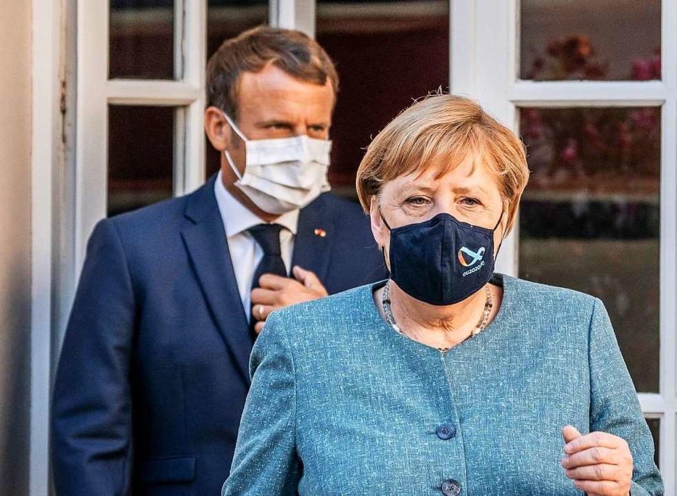 Bundeskanzlerin Angela Merkel und der französische Präsident Emmanuel Macron  | Foto: Michael Kappeler (dpa)