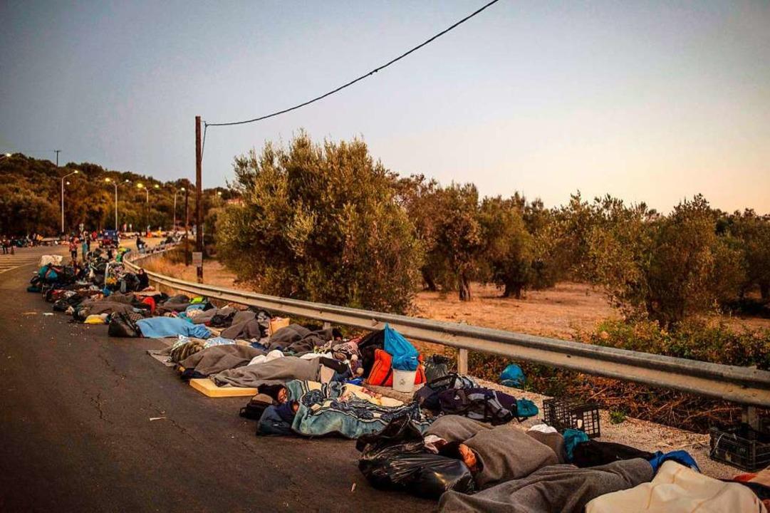 13.000 Menschen sind nach dem Brand obdachlos.  | Foto: ANGELOS TZORTZINIS (AFP)