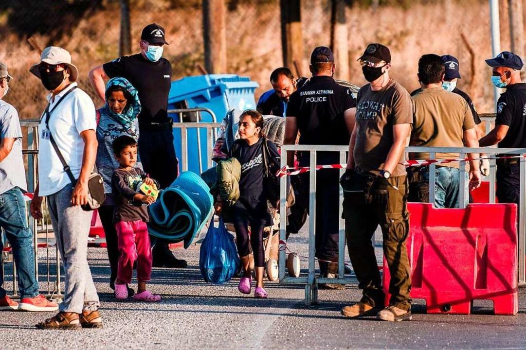 Geflüchtete auf Lesbos: Tausende Mensc...ch dem Brand im Lager Moria obdachlos.    Foto: ANGELOS TZORTZINIS (AFP)