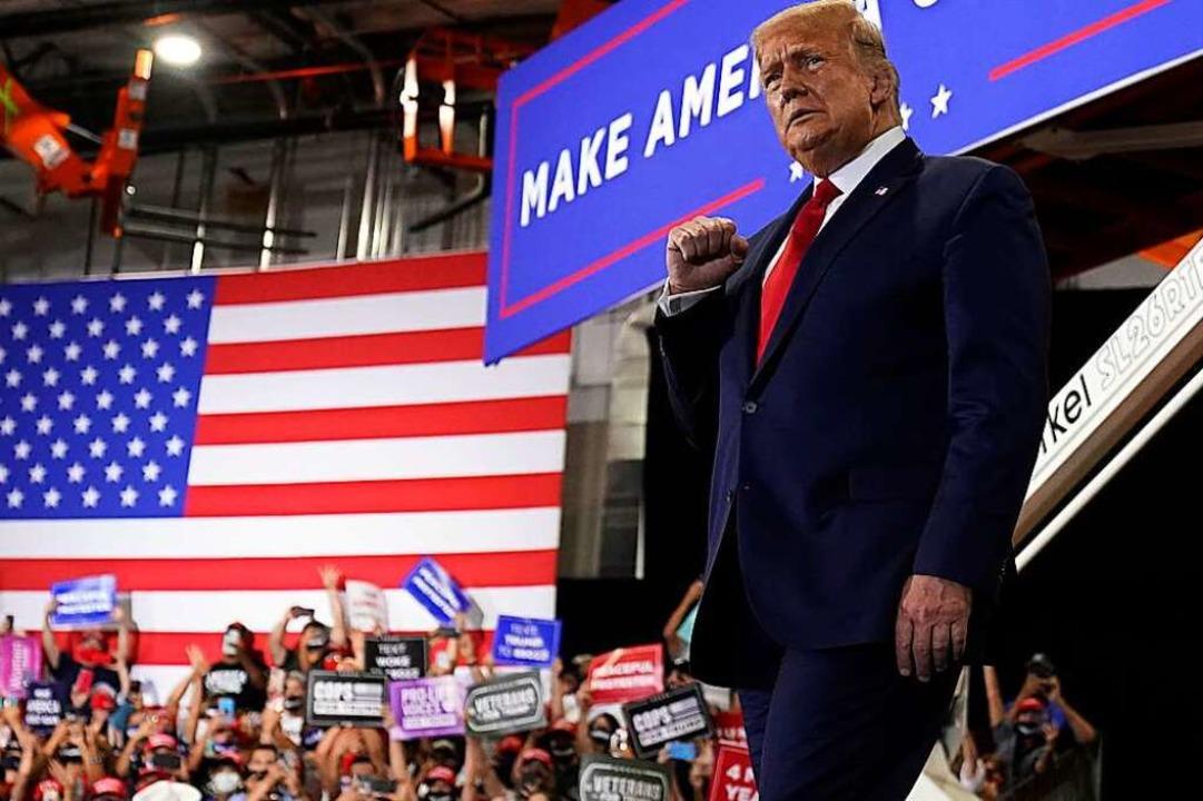 US-Präsident Donald Trump bei einer Wa...er die politische Elite herausfordert.  | Foto: Andrew Harnik (dpa)