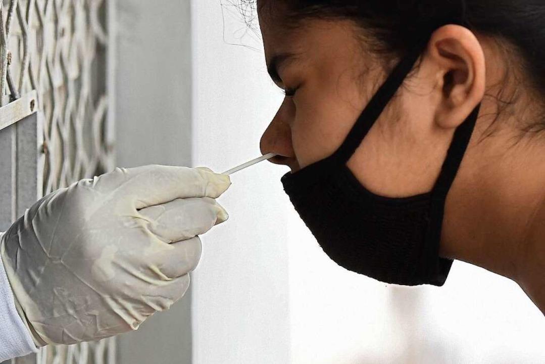 Nicht alle Reiserückkehrer aus Risikog...haben sich testen lassen (Symbolbild).  | Foto: PRAKASH SINGH (AFP)