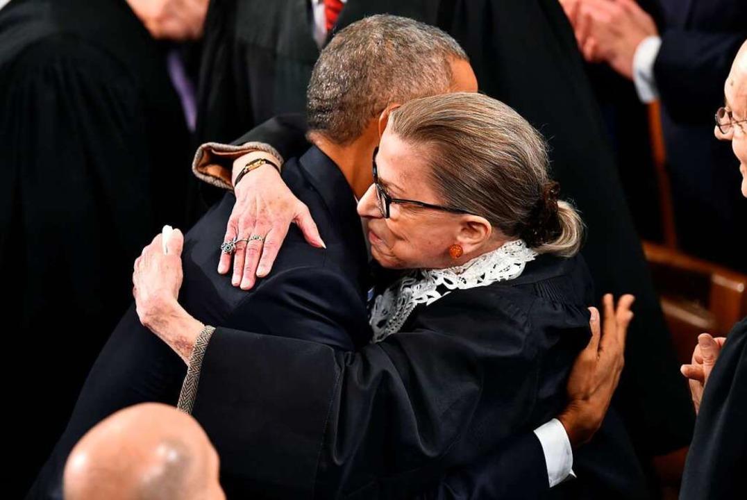 Ginsburg mit Barack Obama im Februar 2009  | Foto: NICHOLAS KAMM (AFP)