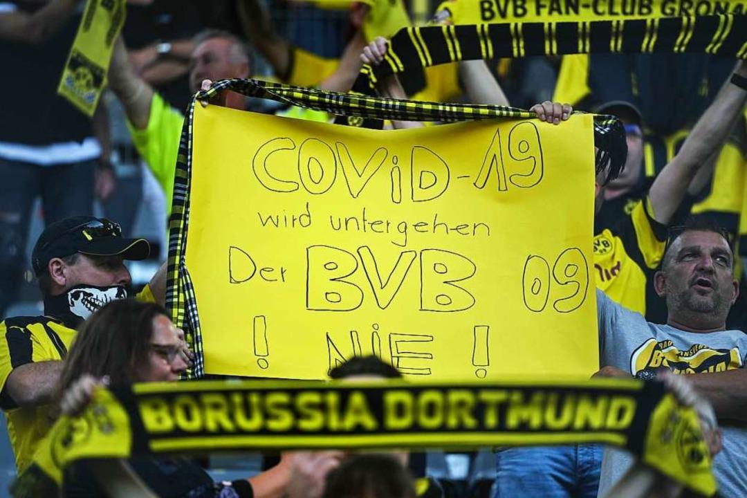 Optimismus auf der Dortmunder Tribüne  | Foto: INA FASSBENDER (AFP)
