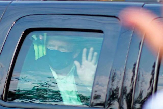 Trump zeigt sich außerhalb des Krankenhauses und erntet heftige Kritik