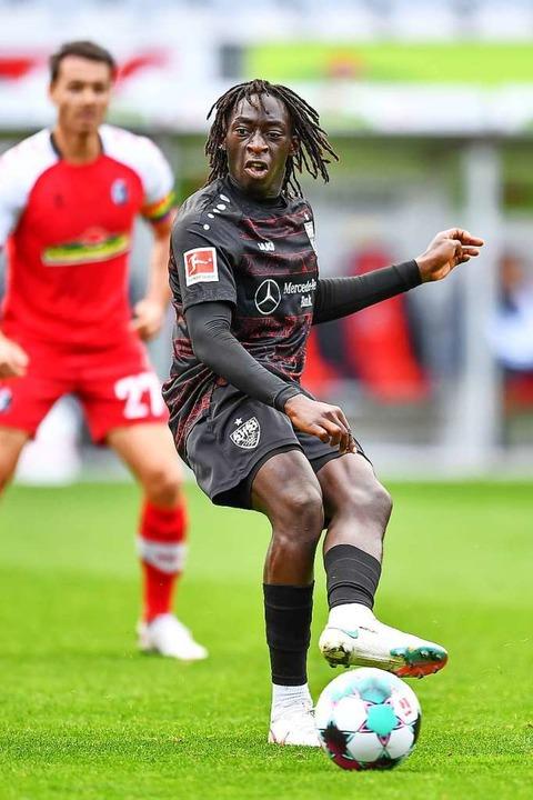 Stuttgarts Doppeltorschütze Tanguy Cou...nd SC-Mittelfeldspieler Nicolas Höfler  | Foto: Achim Keller