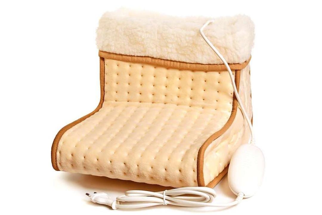 Schuhe aus und das warme Gefühl genießen: Ein elektrischer Fußwärmer  | Foto: spline_x  (stock.adobe.com)