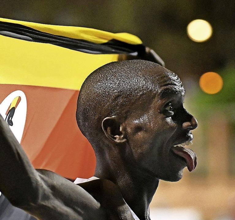 Verbesserte 2020 die Weltrekorde über ...000 Meter: Joshua Cheptegei aus Uganda  | Foto: JOSE JORDAN (AFP)