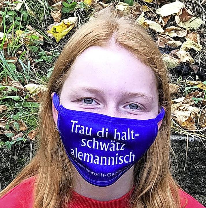 <BZ-FotoAnlauf>Muettersproch: </BZ-Fot...annisch  sollen Maskenträger schwätze.    Foto: Muettersproch Gsellschaft