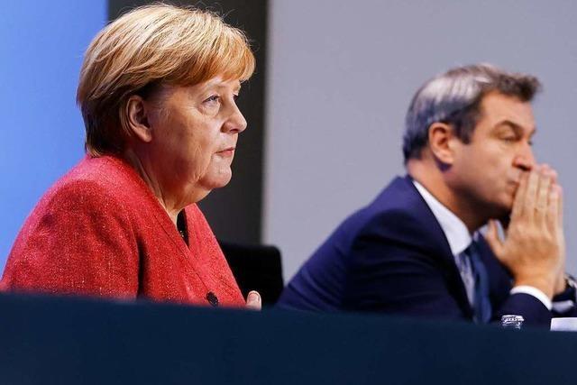 Merkel mahnt: Bürger sollen private Kontakte auf ein Minimum beschränken