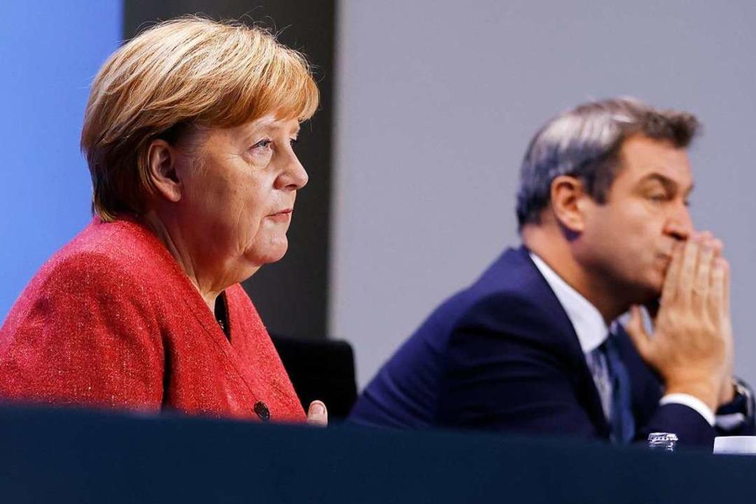 Bundeskanzlerin Angela Merkel und Bayerns Ministerpräsident Markus Söder    Foto: Odd Andersen (dpa)