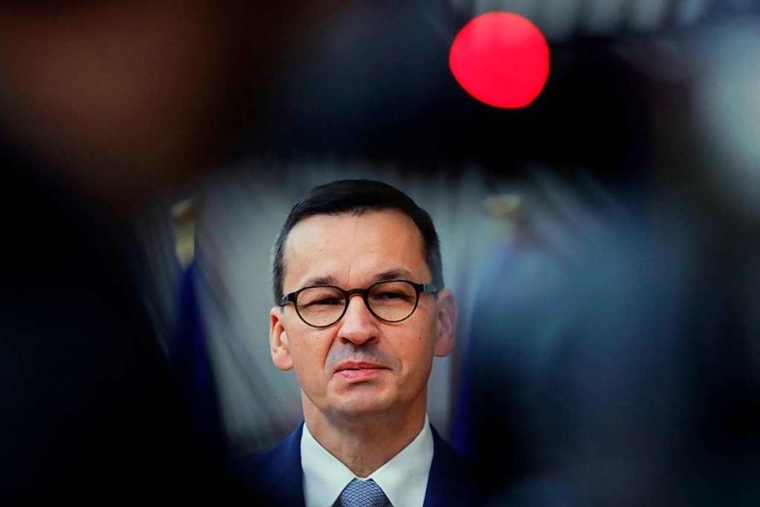 Polens Regierungschef Mateusz Morawiecki  | Foto: OLIVIER HOSLET (AFP)