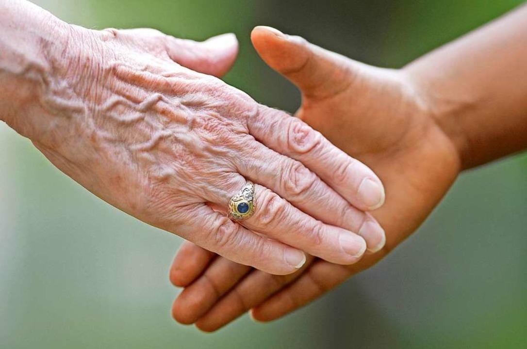 Handschlag.  | Foto: Uwe Anspach (dpa)