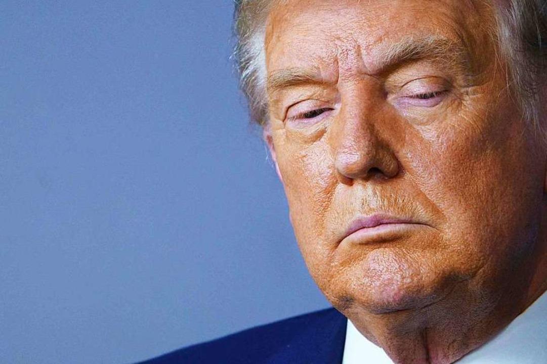 Der Noch-US-Präsident sieht sich massi...uck aus den eigenen Reihen ausgesetzt.  | Foto: MANDEL NGAN (AFP)
