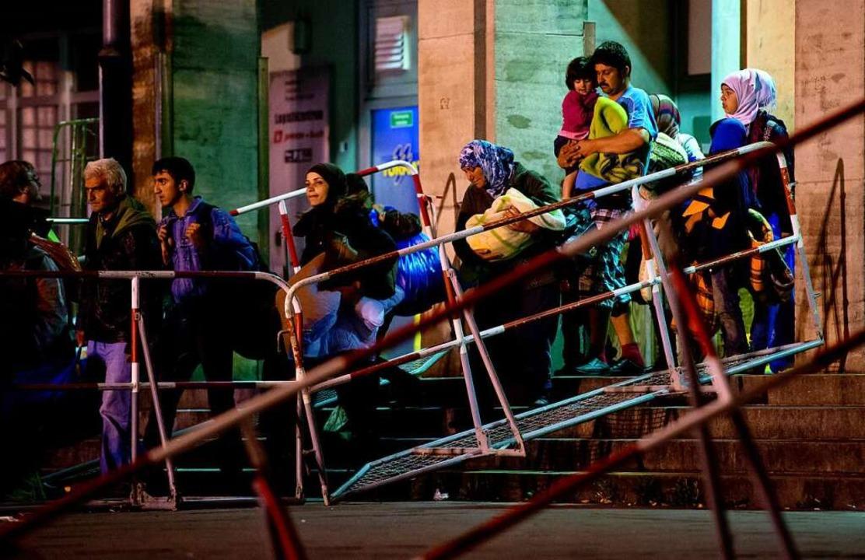 September 2015: aus Syrien geflohene Menschen auf dem Münchner Hauptbahnhof  | Foto: Sven Hoppe