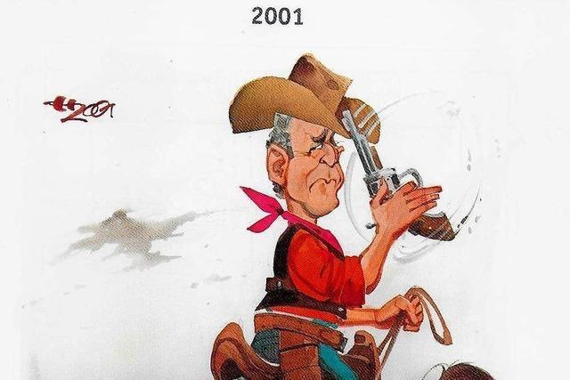 Karikaturist Horst Haitzinger rundet sein Werk mit