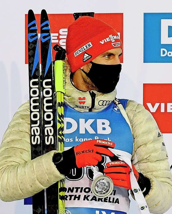 Maskenmann mit Silber: Arnd Peiffer  | Foto: ANTTI AIMO-KOIVISTO (AFP)