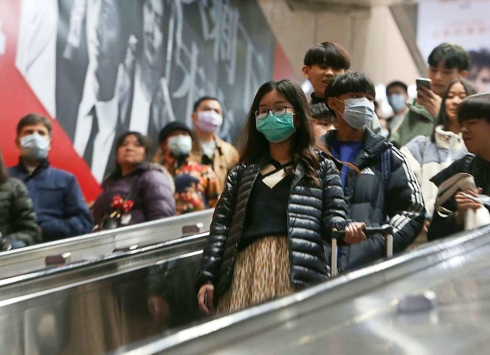 U-Bahn-Nutzer in Taipei im Januar. Dam...ktionen in Hongkong, Taiwan und Macao.    Foto: Chiang Ying-Ying (dpa)