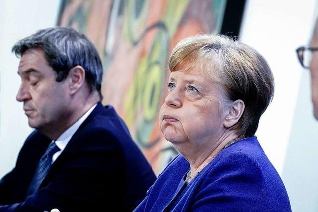 Merkel und Söder schließen schärfere Corona-Regeln nicht aus