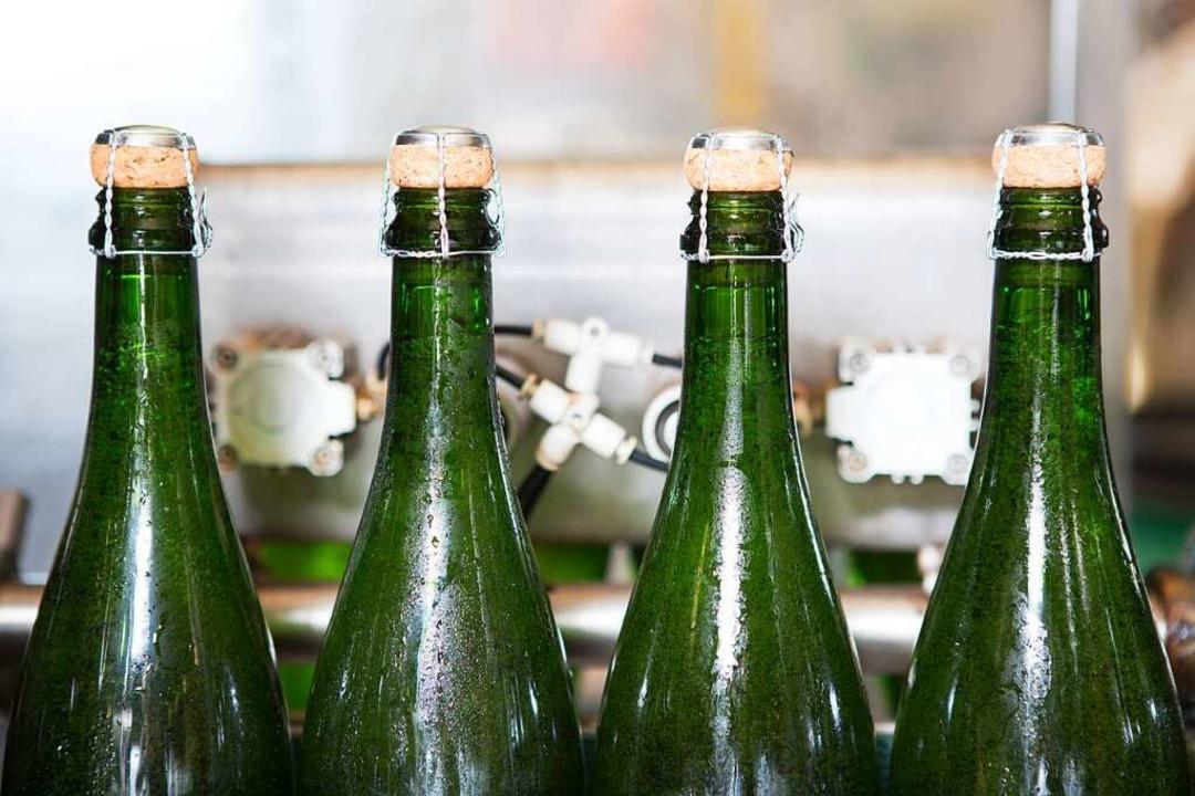 Sektflaschen in der Produktion  | Foto: Sektkellerei Reinecker