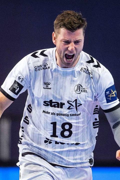 Erfolgreichster Kieler Werfer mit acht...avon sechs Siebenmetern: Niclas Ekberg  | Foto: Marius Becker (dpa)