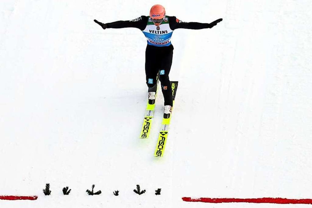 In der Tageswertung auf Rang fünf gela...iter in der Gesamtwertung: Karl Geiger  | Foto: Daniel Karmann (dpa)