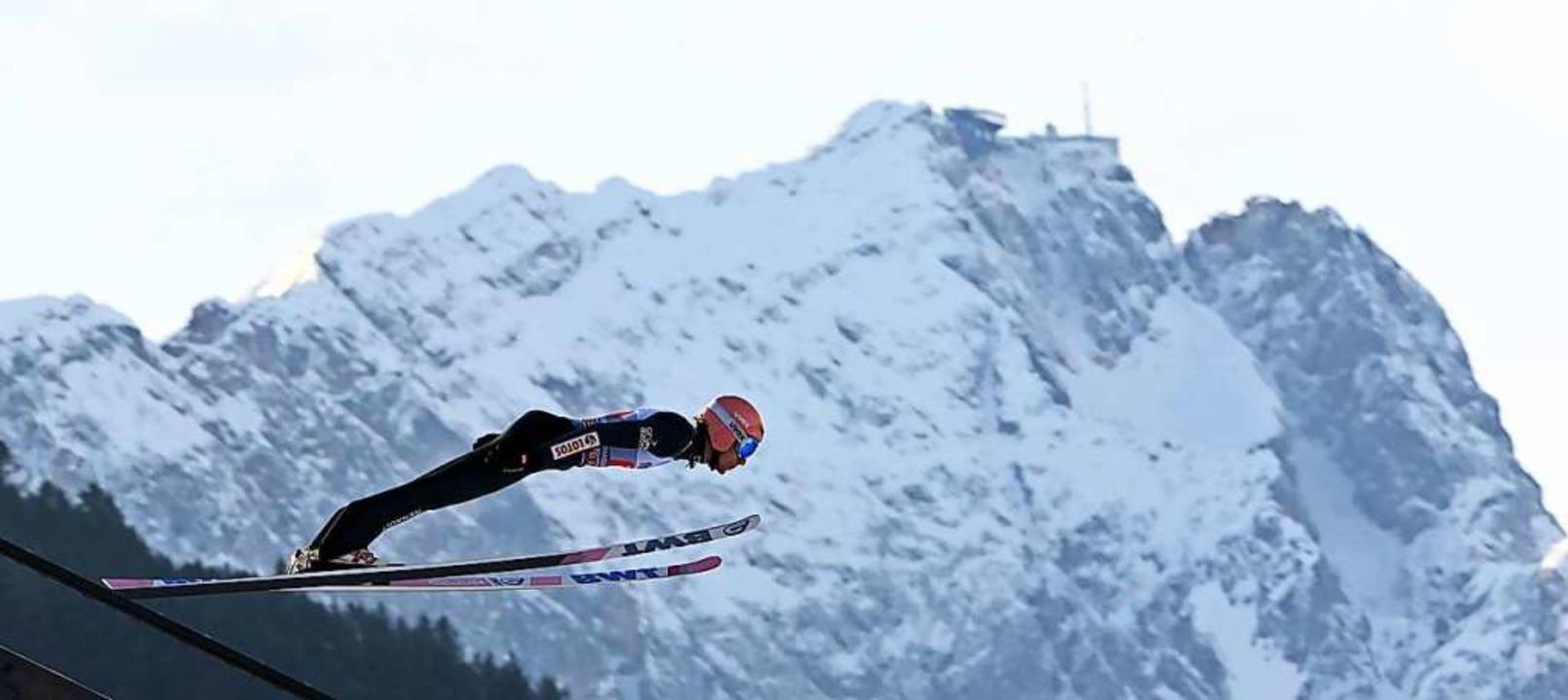 Dawid Kubacki, der Sieger des Springens am Neujahrstag  | Foto: CHRISTOF STACHE (AFP)