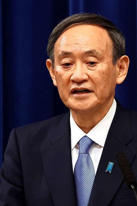 Yoshihide Suga, Premierminister von Ja...ferenz in seiner offiziellen Residenz.  | Foto: Yoshikazu Tsuno (dpa)