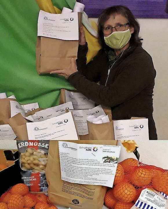 <BZ-FotoAnlauf>AK Integration</BZ-Foto... packt die Tüten für die Geflüchteten.  | Foto: Schopfheim hilft/AKI