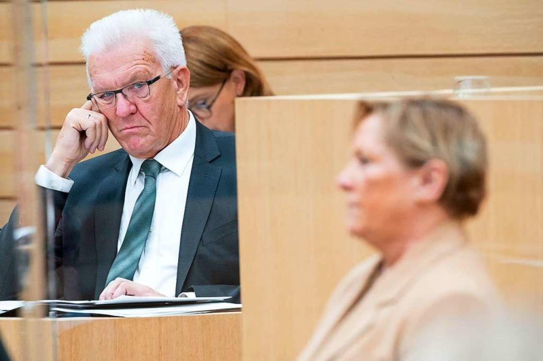 Ministerpräsident Winfried Kretschmann...zenkandidatin Susanne Eisenmann (CDU).  | Foto: Sebastian Gollnow (dpa)