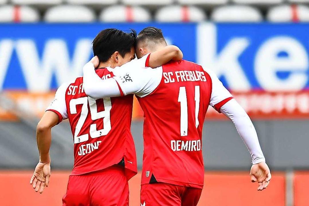 Die beiden Torschützen miteinander.  | Foto: Achim Keller/SC Freiburg