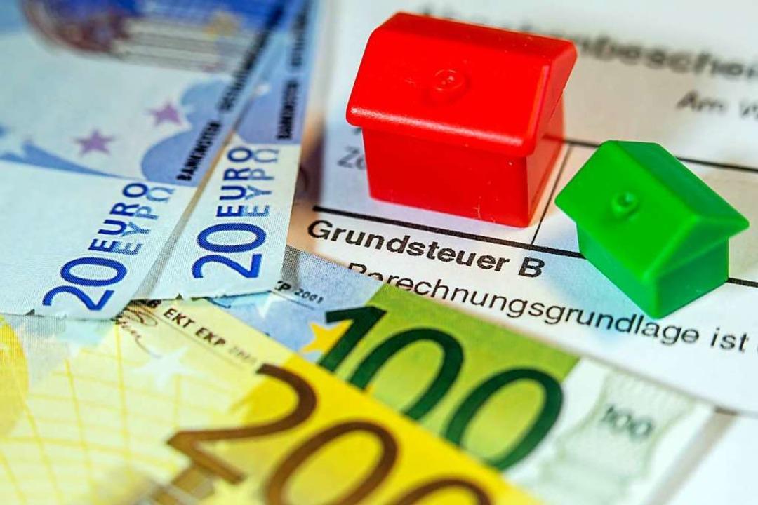 Die Grundsteuer in Heuweiler steigt, d...ebesatz für Gewerbetreibende gesenkt.   | Foto: Jens Büttner (dpa)