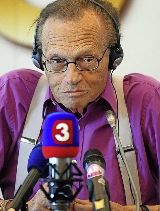 Mit Hosenträgern: Larry King  | Foto: SAMUEL KUBANI (AFP)