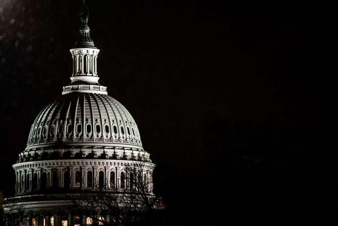 Das Kapitol in Washington ist sowohl S...achment-Verfahrens gegen Donald Trump.    Foto: Samuel Corum (AFP)