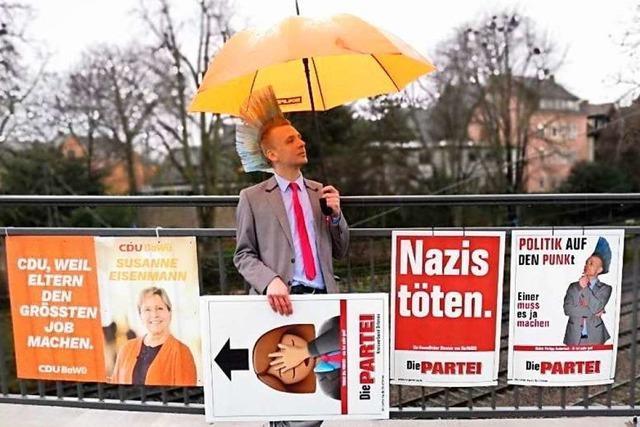 Polizei in Offenburg entfernt Parteiwerbung mit Slogan