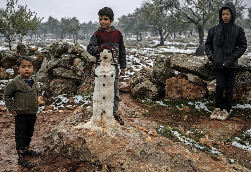Syrische Kinder in einem Flüchtlingslager  | Foto: Anas Alkharboutli (dpa)