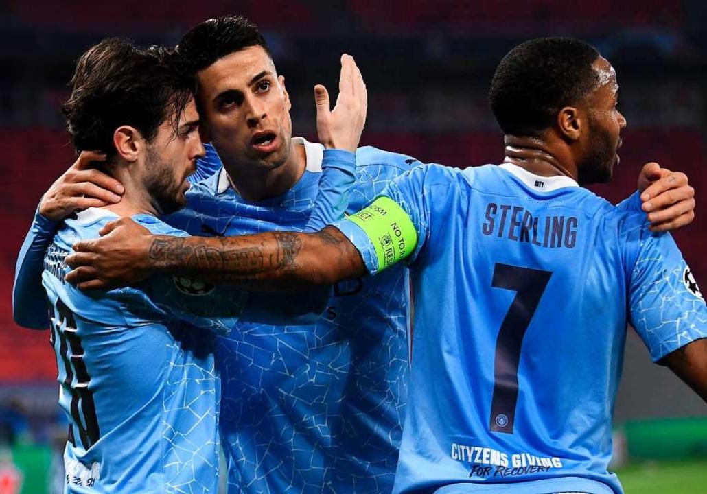 Spieler von Manchester City feiern das 1:0.   | Foto: ATTILA KISBENEDEK (AFP)