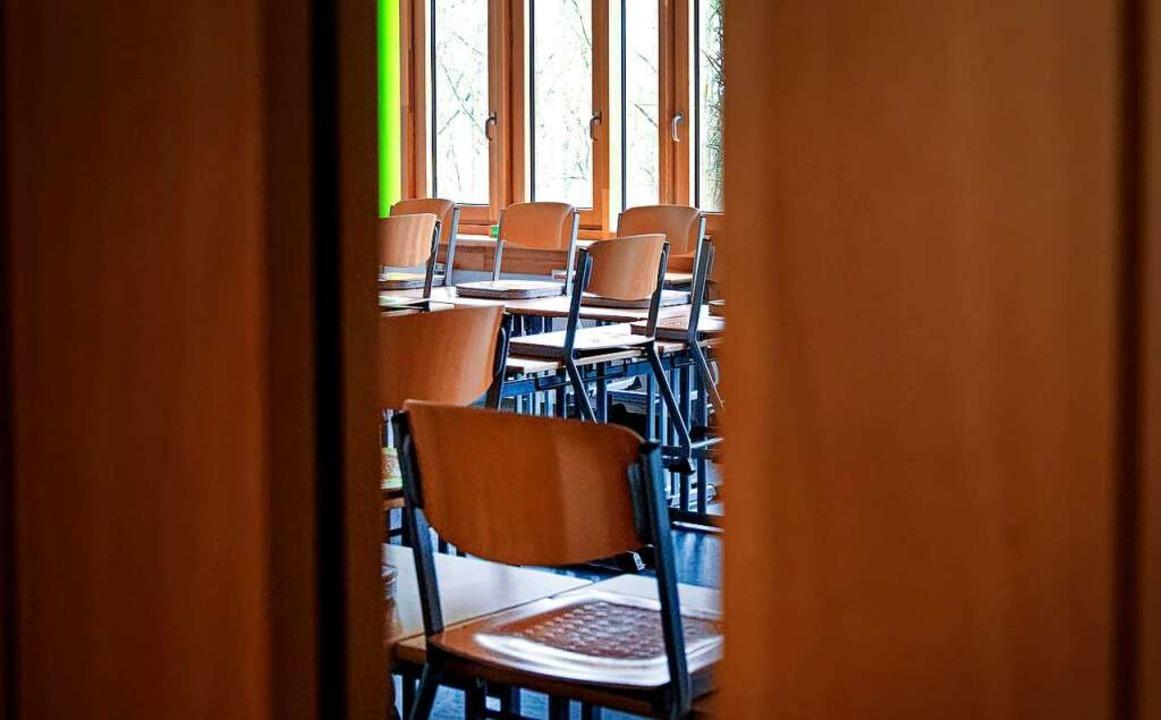 Schulen zu schließen sollte Ultima Rat...an ein Drittel der Kinder faktisch ab.    Foto: Henning Kaiser (dpa)