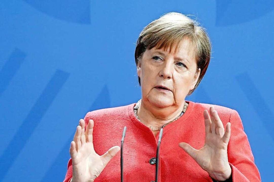 Bundeskanzlerin Angela Merkel (CDU) tr...ür Frauen und Männer ein (Archivbild).  | Foto: Jörg Carstensen (dpa)