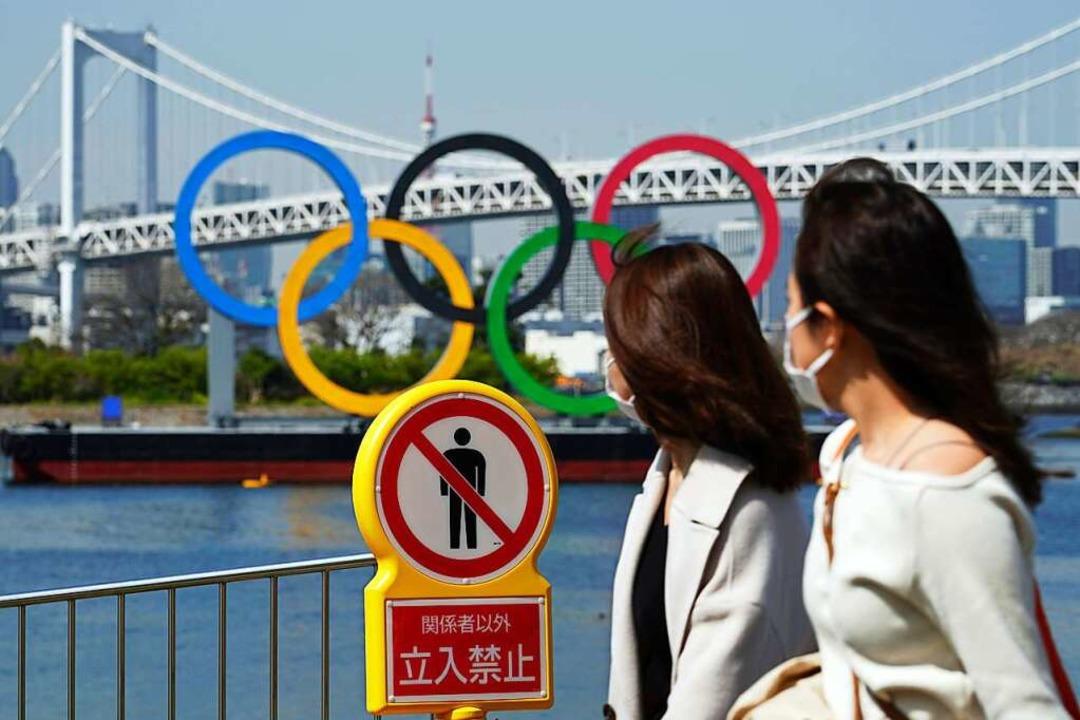 Ausländische Touristen werden bei den ...mmerspielen in Tokio nicht dabei sein.    Foto: Eugene Hoshiko (dpa)