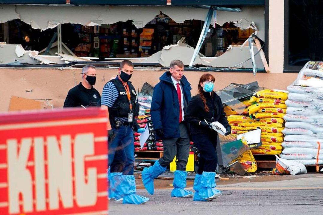 Ermittler am Tatort.    Foto: JASON CONNOLLY (AFP)