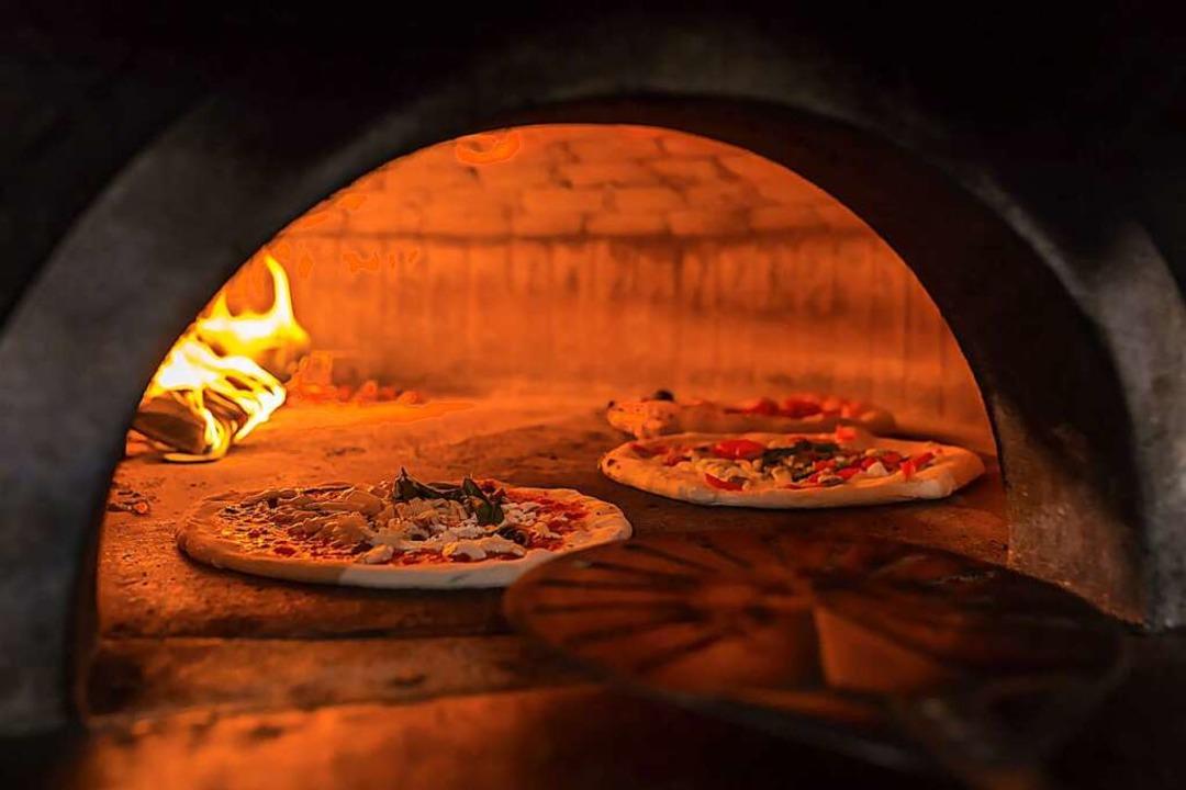 Pizza gehört heute wie selbstverständlich auf den Speisezettel der Deutschen.    Foto: Mazur Travel  (stock.adobe.com)