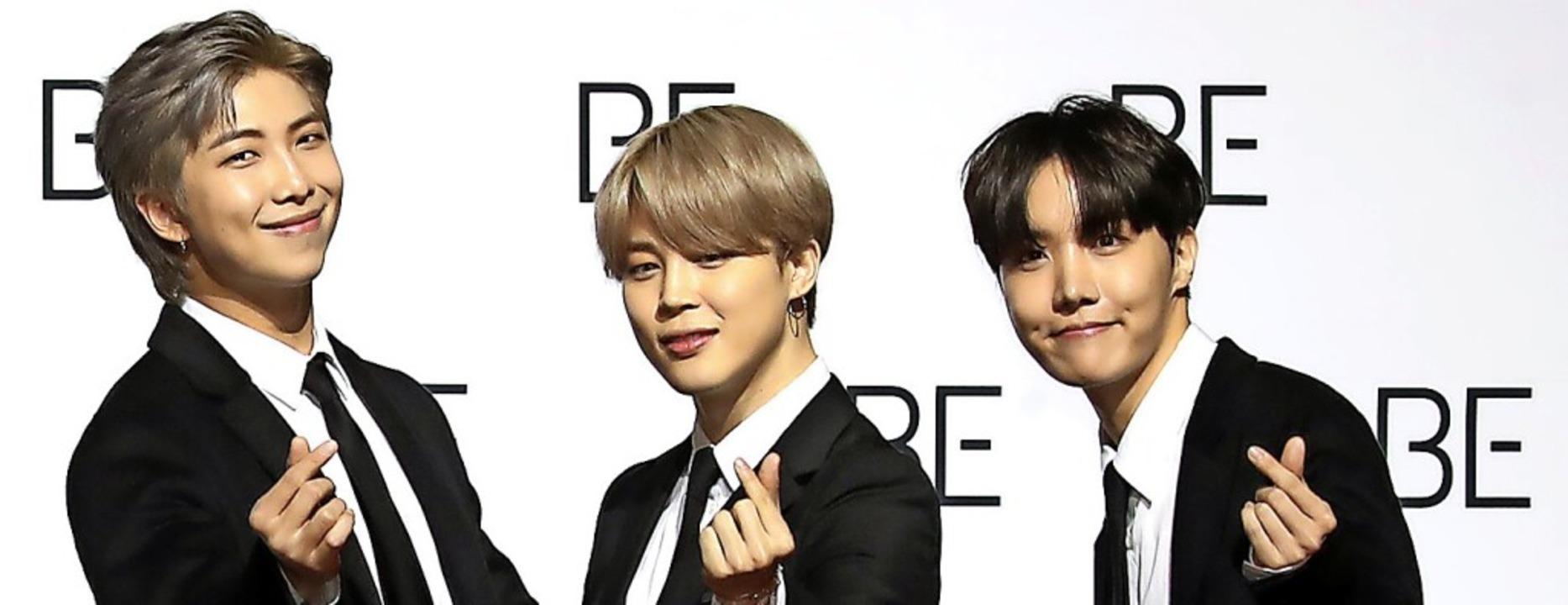 Drei der sieben Boygroup BTS-Mitglieder  | Foto: dpa