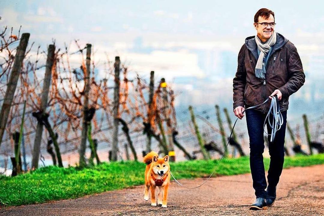 Christoph Weinmann mit seiner Hündin Hachi  | Foto: Horst Rudel