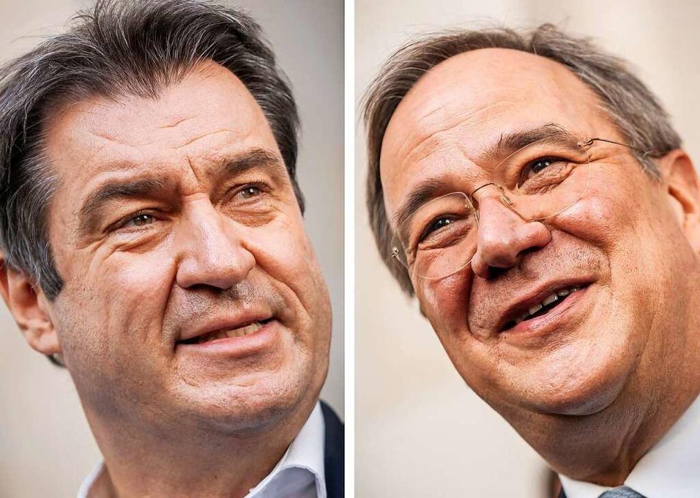 Markus Söder und Armin Laschet: Derzei...enten für den geeigneteren Kandidaten.  | Foto: Michael Kappeler (dpa)