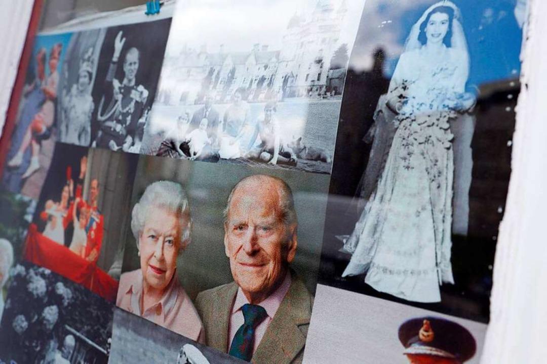 Fotos des Königspaars  | Foto: ADRIAN DENNIS (AFP)