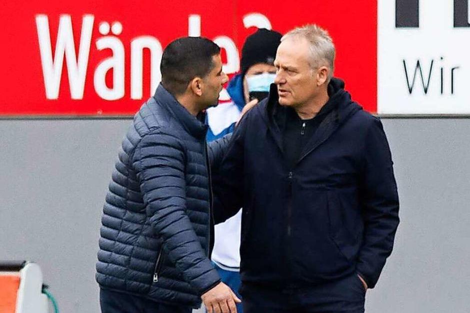 SC-Trainer Christian Streich und sein Schalker Kollege Grammozis vor Anpfiff. (Foto: Tom Weller (dpa))
